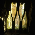 Wine bottles embedded in concrete allow soft light to enter the barrel cave.